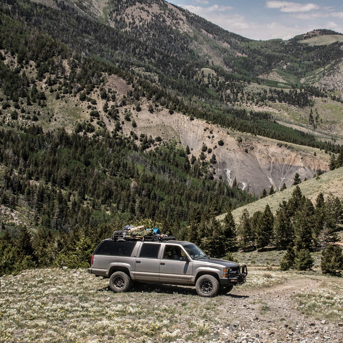 4x4 tours pictured in front of rocky mountains - adventure travel at its best