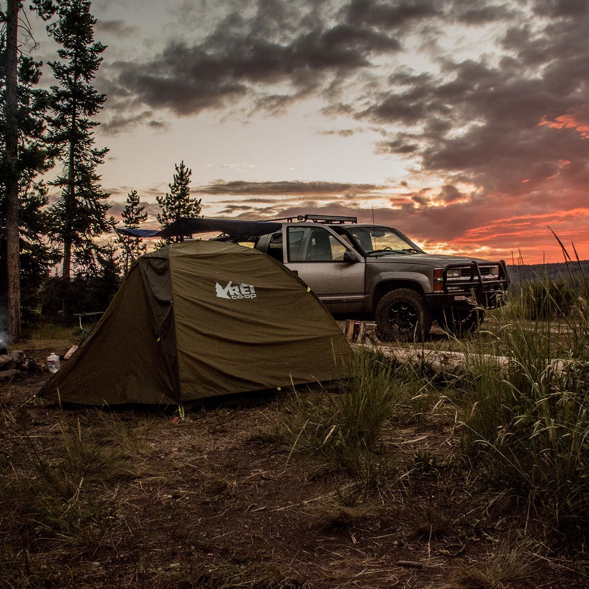 Adventure travel with 4x4 and tent in the foreground